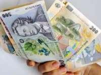 Câștigul salarial mediu net lunar ar putea crește cu 6,4%, în 2015, până la 1.767 lei