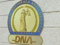 Doi maramureșeni trimiși în judecată de DNA pentru fals
