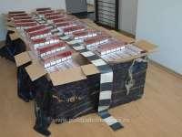 FOTO - Român implicat în contrabandă cu țigări reținut la frontieră. Peste 23.000 de pachete cu țigări confiscate