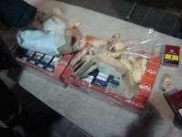 FOTO - Țigări ascunse în cutii de prăjituri, depistate de către polițiștii de frontieră