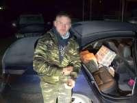 FOTO & VIDEO: SIGHET - BMW burdușit de țigări de contrabandă, condus de un tânăr cu multe dosare penale și fără permis
