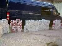 FOTO&VIDEO - 15.000 de pachete cu ţigări, ascunse în pereţii dubli, portiere sau bordul unor autovehicule
