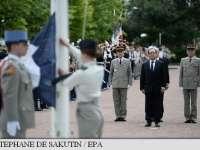 Francois Hollande a dat startul festivităților de pe Champs-Elysees de Ziua Națională a Franței