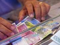 Francul elvețian, la valori record, după ce Banca Națională a Elveției a abandonat pragul de 1,20 franci pentru un euro