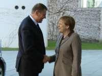 Iohannis va avea întâlniri cu Merkel şi Macron