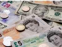 Lira sterlină a ajuns la cursul minim al ultimilor 31 de ani în raport cu dolarul american