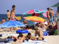 Medicii recomandă 90 de minute/zi de stat în soare; excesul creşte riscul de apariție a melanomului