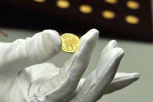 Monede dacice, recuperate de autorități din Italia în urma unei licitații pe internet
