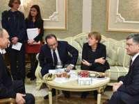 """Reacții după negocierile de la Minsk - Putin: """"N-a fost cea mai bună noapte din viața mea""""; Merkel: """"Nu-mi fac nicio iluzie!"""""""