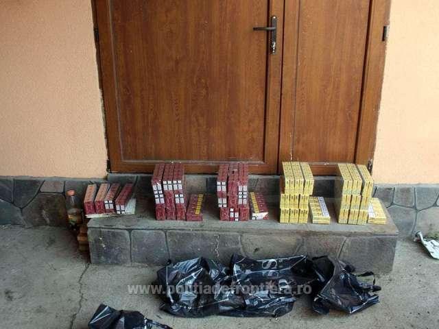 FOTO & VIDEO - Descinderi la membrii unei rețele specializate în contrabanda cu țigări