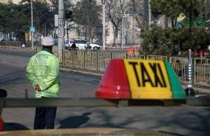 Taximetrist din București, reţinut după ce a tâlhărit doi turişti britanici