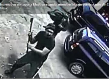Un interlop a intrat cu toporul într-un service auto, distrugând totul în cale