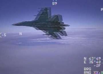 VIDEO - Incident aerian deasupra Mării Negre. Un avion rusesc de război interceptează şi provoacă un avion american