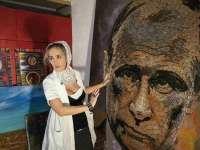 VIDEO - Vladimir Putin, înfăţişat din mii de cartuşe culese din zona de conflict din Ucraina